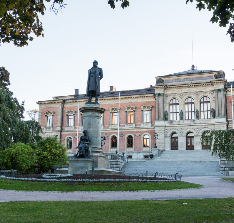 A statue of Erik Gustaf Geijer in front of the University Main Building