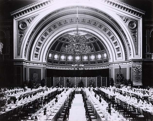 Several rows of long tables set in the University Grand Auditorium