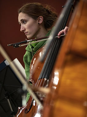 A woman playing cello